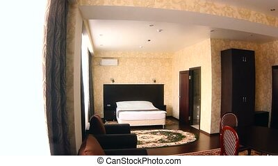 chair motion room Interior hotel bedroom with chairs and...