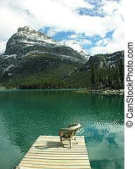Chair on a wooden pier, Lake O'Hara, Yoho National Park,...