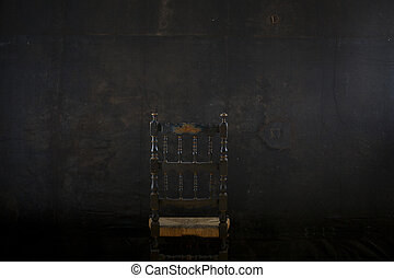Chair on black wall