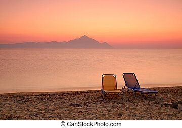 Chair on the sunset beach