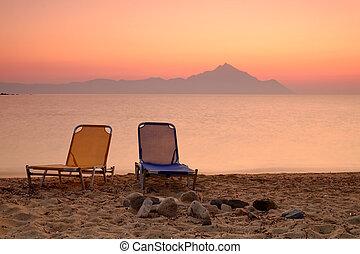 Chair on the sunset beach