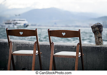 Chair Seats near the Seaside Holiday Concept