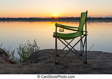 chair silhouette on sunset background