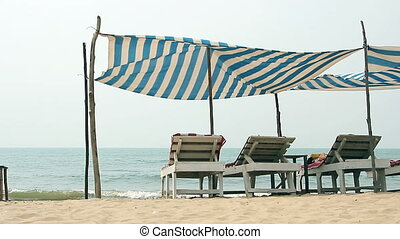 Chair with awning on the Beach