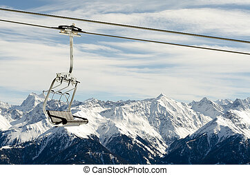 chairlift before mountain panorama