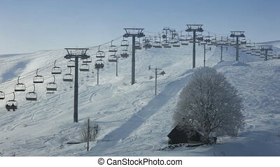 chairlift in Le Corbier, French Alps - wide angle clip of...