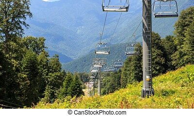 Chairlift in the summer. Time Lapse. Gazprom center, Sochi,...