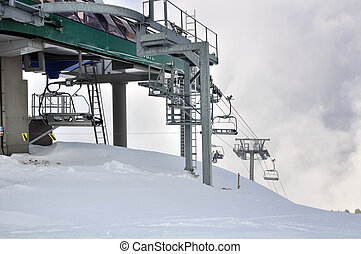 chairlifts in snowy mountain