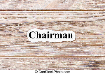CHAIRMAN of the word on paper. concept. Words of CHAIRMAN on a wooden background