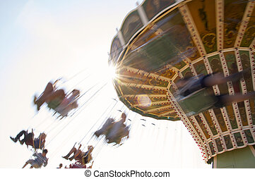 Chairoplane - People having fun on a retro chairoplane at a...