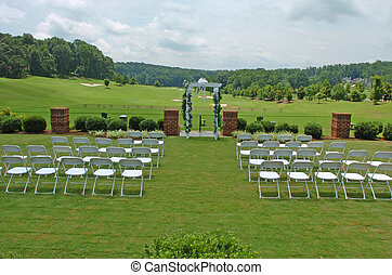 Chairs and arch for wedding ceremony