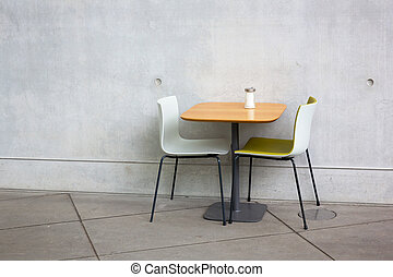 chairs and table at open-air cafe