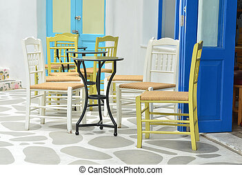 Chairs and tables at outdoor cafe