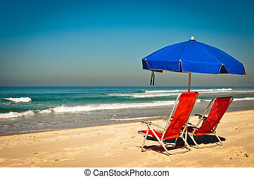 Chairs and Umbrella in the Beach