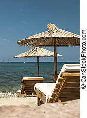 Chairs and umbrella on a beach.