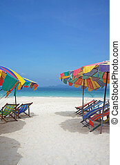 chairs and umbrella on stunning tropical beach