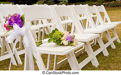 Chairs at a Wedding - White Folding Chairs at an Outdoor...