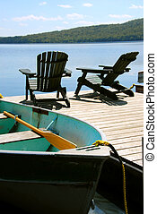 Chairs boat dock - Paddle boat and two adirondack wooden ...