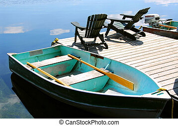Chairs boat dock - Paddle boat and two adirondack wooden...