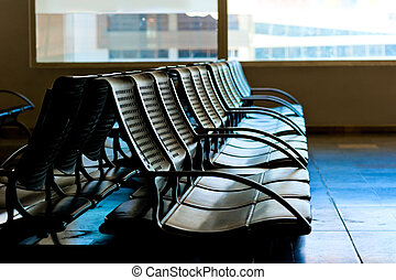 Chairs for waiting plane at the airport