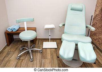 Chairs in a pedicure beauty salon. Interior of empty modern nail salon. Work places for masters of manicure. Pedicure cabinet.