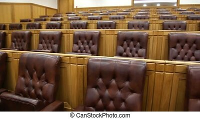 chairs in conference hall with wooden finish, panning