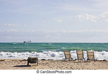 Chairs on Beach and Freighter