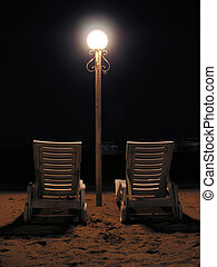 chairs on night beach -           chairs on night beach