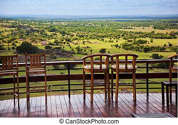 Chairs on terrace. Savanna landscape in Serengeti, Tanzania,...