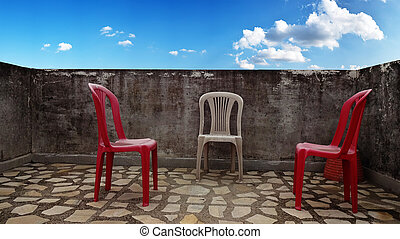 Chairs on the roof with sky background