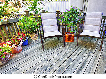 Chairs on wooden deck