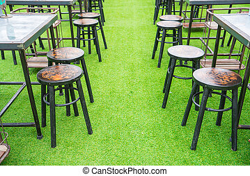 Chairs sitting on grass