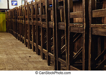 chairs stand in a row near the bar