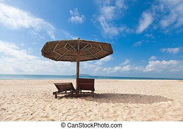 chairs umbrella on beach