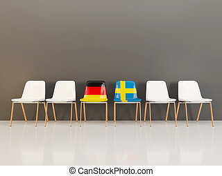 Chairs with flag of Germany and sweden in a row