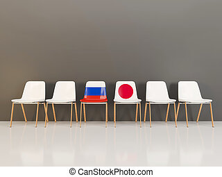 Chairs with flag of Russia and japan