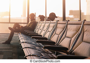Chairs with passengers at the airport