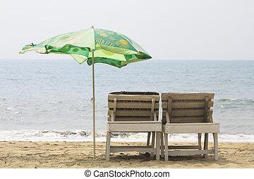 Chairs with Umbrella on the beach near ocean