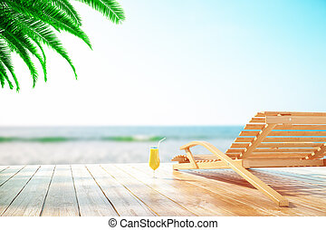 Chaise longue and cocktail at the beach with clear sky and palm tree