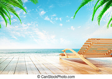 Chaise longue at the beach with clear sky and palm trees