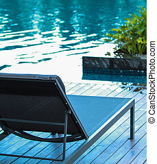 Chaise longue - Closeup chaise longue with swimming pool...