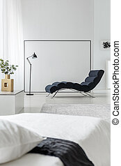 Chaise lounge on empty wall