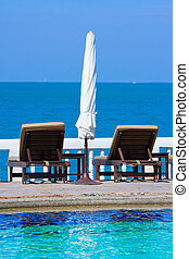 Chaise lounges by the sea in Thailand
