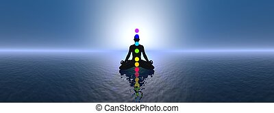 Chakras at blue sunset - 3D render - Silhouette of a man...