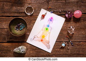 Chakras over a human body - Chakras illustrated over human...