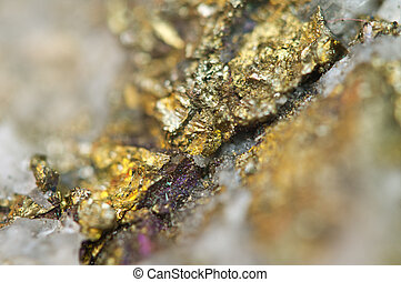 Chalcopyrite, It has the chemical formula (CuFeS2). Copper iron sulfide mineral. Macro. Beautiful fantastic background for successful projects.