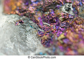 Chalcopyrite in quartz, It has the chemical formula...
