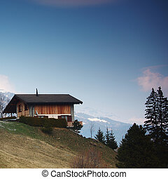 Wooden alpine chalet in the mountains  Wooden snow covered