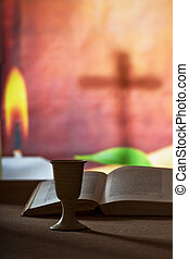 Chalice of wine and open bible