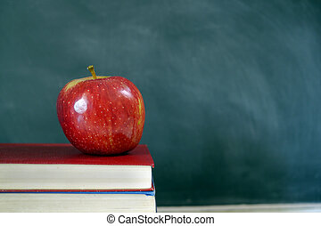 chalk and apple on old textbook - red apple on old textbook...